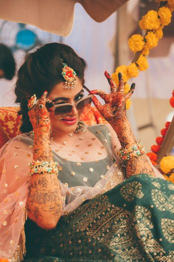 Bridal portrait on mehendi wearing sunglasses