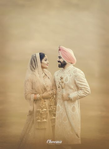 Sikh couple portrait in matching pastel outfits