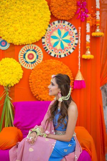 Floral decor with unique props for mehendi ceremony
