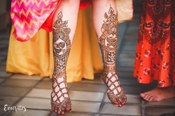 Bridal feet mehendi with musical instruments