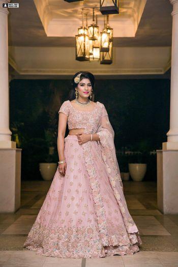 Photo of Light pink floral engagement lehenga
