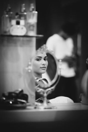 Photo of bride looking in mirror
