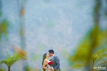 Pre wedding couple kissing shot