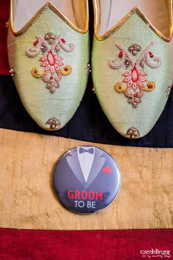Groom shoes and badge