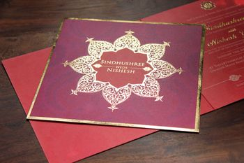 Photo of purple and red wedding card