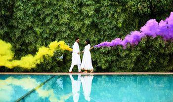 Smoke stick prop in pre wedding shoot yellow purple