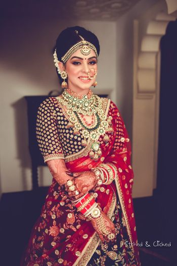 jadau jewellery worn by bride in red
