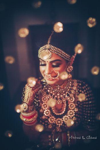 Pretty bridal portrait through dupatta