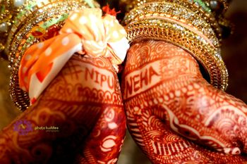 Mehendi with bride and groom name hashtag