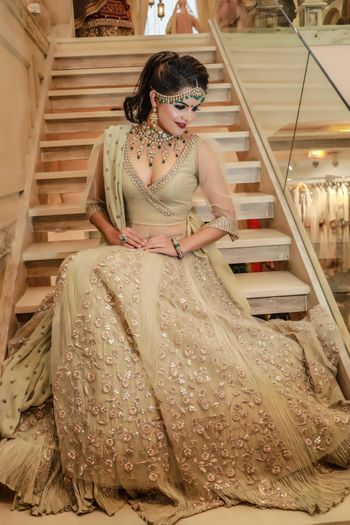 Gold monotone lehenga with sequins for embroidery