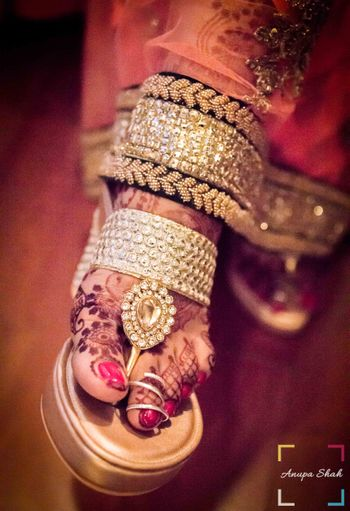 Bride's Feet with Toe Ring and Studded Wedges