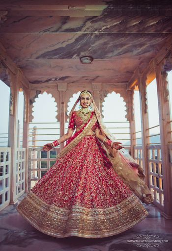 Photo of Red and gold bridal lehenga with sequin work