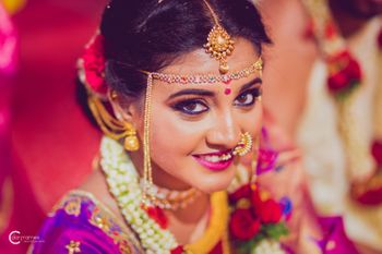 South Indian bridal look smokey eyes with pink lips