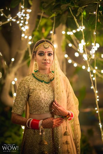 Bride in gold with green jewellery