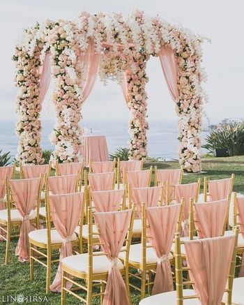 Pretty peach fairytale mandap and chair decor