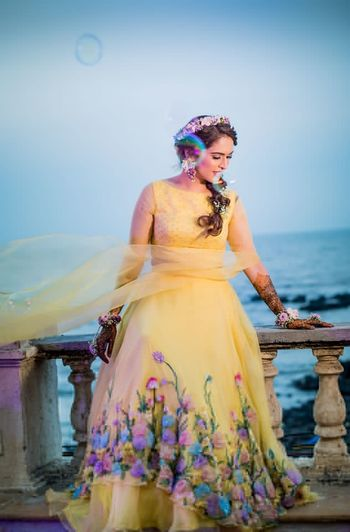 Photo of Mehendi gown in yellow with appliqué work