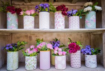 Cute Parisian decor with mix and match vases and flowers