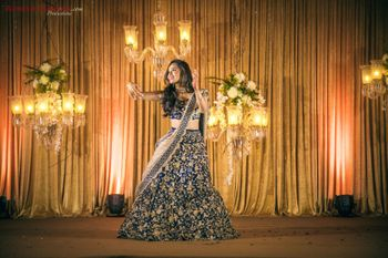 Photo of Bride dancing on sangeet shot