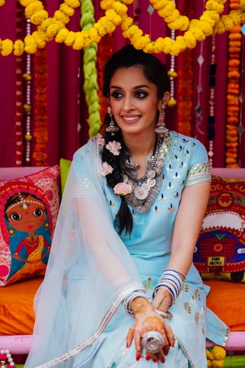 Photo of Mehendi bridal Portrait with blue lehenga