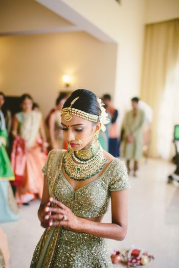 A bride in shimmer lehenga