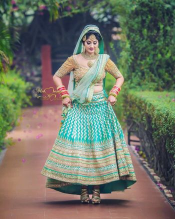Photo of Unique and offbeat bridal hue turquoise lehenga