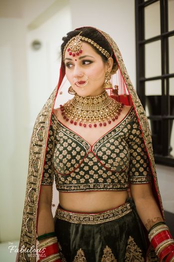Red and black bridal lehenga with unique blouse