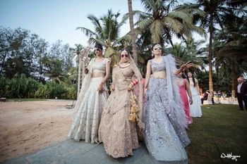 Bride and sisters in pastel outfits