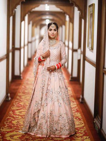 Light pink Anarkali with silver work for Sikh bride