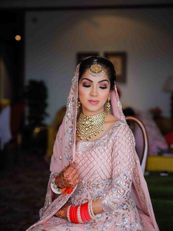Sikh bride in light pink bridal portrait