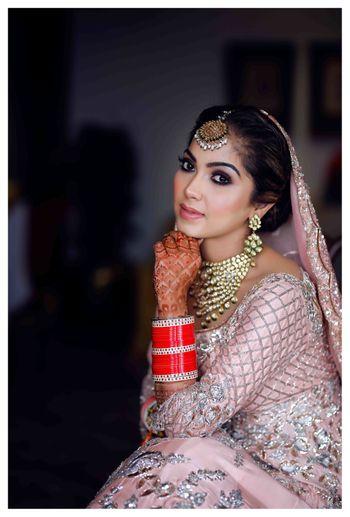 Bridal pose idea in light pink lehenga