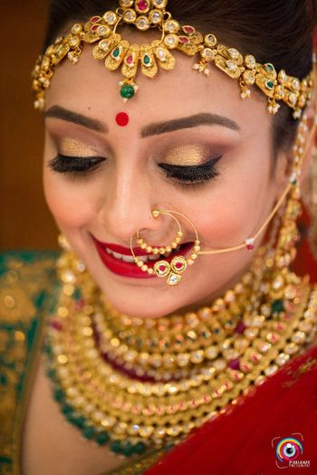 South Indian bride with colourful jewellery