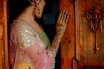 Mehendi bridal portrait showing off mehendi