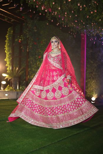 Beautiful pink bridal lehenga with twirling bride