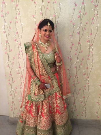 Photo of mint and peach lehenga