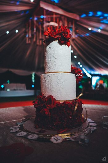 Photo of White and red wedding cake