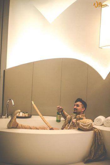 Groom chilling before wedding in bath tub