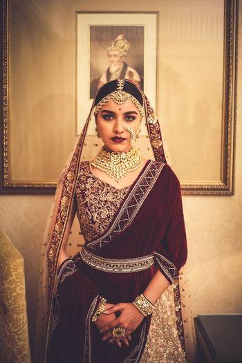 Velvet maroon bridal lehenga with waist belt