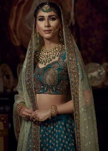 Teal bridal lehenga with gold work