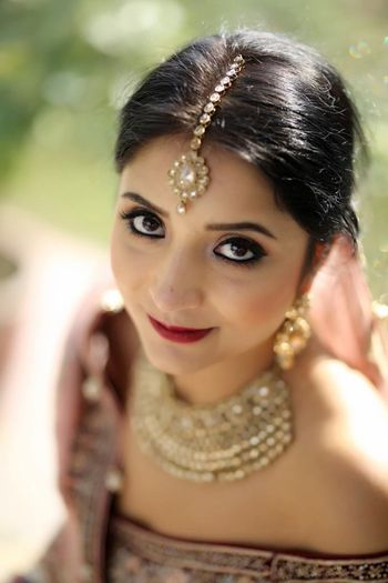 Bridal makeup with heavily kohled eyes