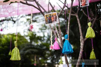 Displaying memories with tassels on tree