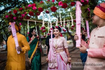 Bride entering under Phoolon ki chadar