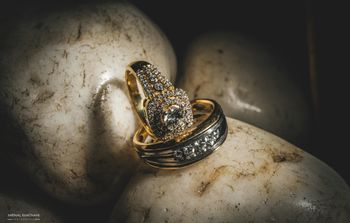 His and her solitaire engagement ring photography idea