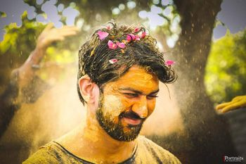 Fun shot of a groom to be at a haldi function