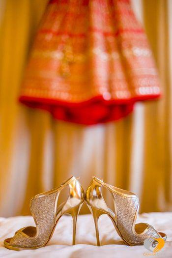 Gold shimmery bridal heels stiletoes