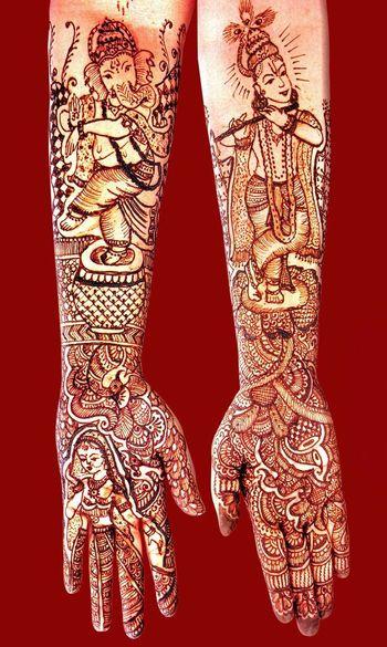Motifs of Lord ganesha and lord krishna in mehendi designs
