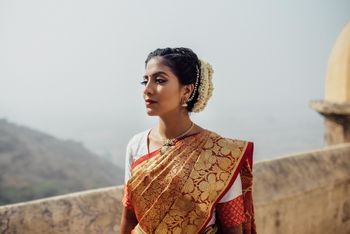 Unique gold and red kanjeevaram saree with white blouse for the bride to be