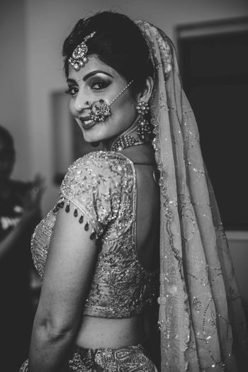 Black and white bridal portrait looking back