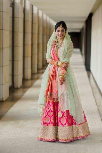 Pink bridal benarasi lehenga with pista green dupatta