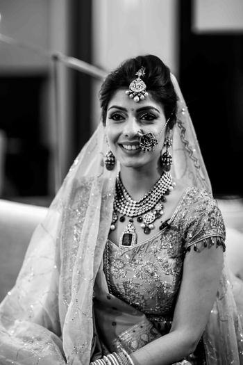 Black and white bridal portrait with unique jewellery