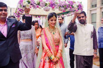 Bridal entry portrait under purple phoolon ka chadar